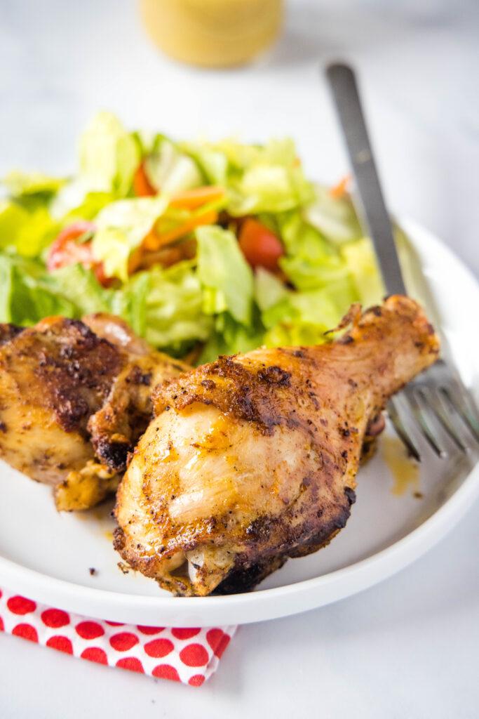 chicken drumsticks on a white plate