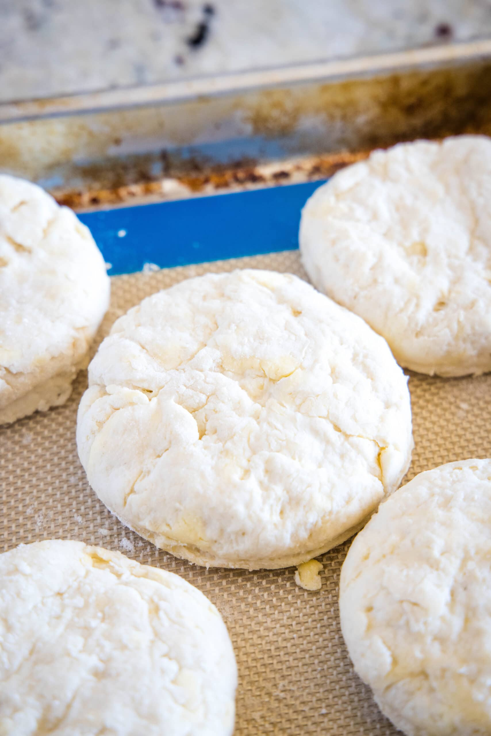 cut biscuit dough on baking tray