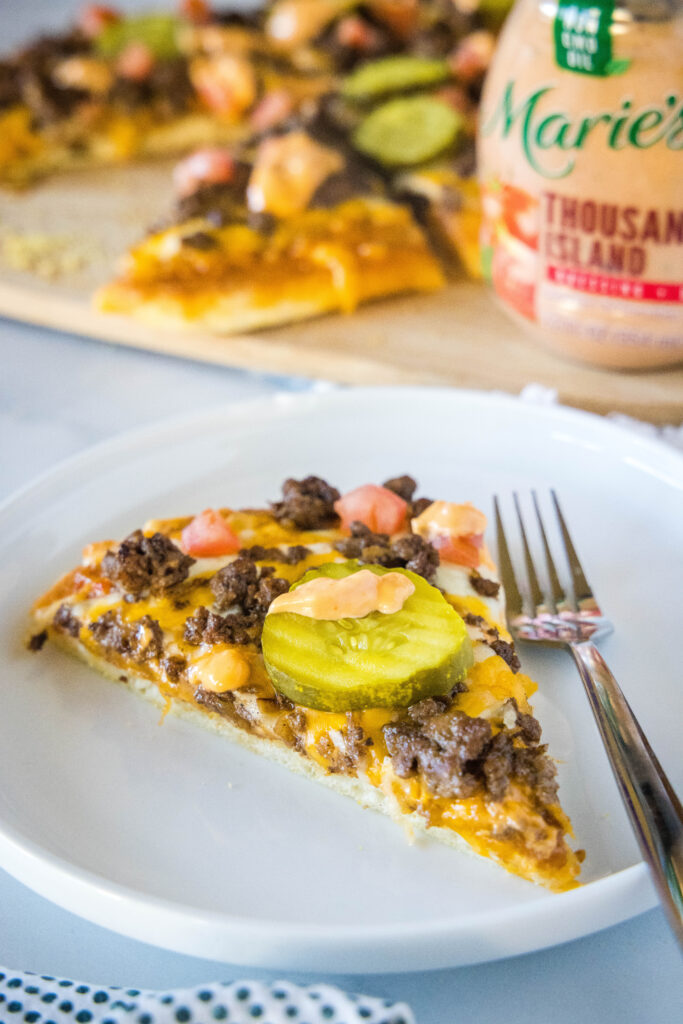 cheeseburger pizza slice on a plate