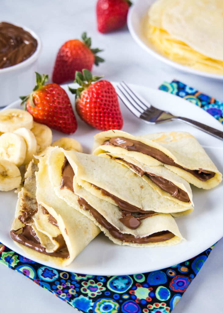 crepes filled with nutella on a plate