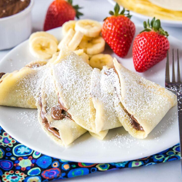 close up of crepes filled with nutella on a plate