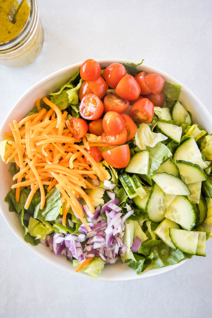 green salad with the veggies on top