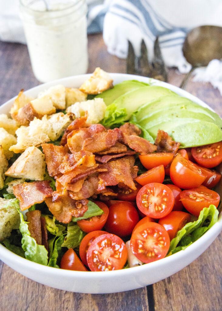 BLT salad ingredients arranged in a bowl