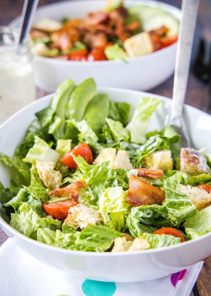 close up of blt salad tossed together in a bowl