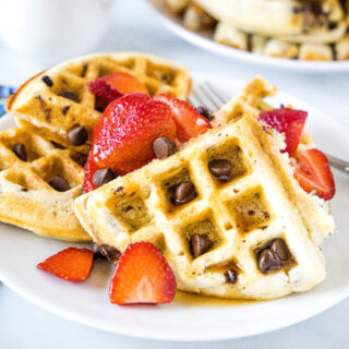 Chocolate Chip Waffles - Light and fluffy waffles full of chocolate chips. The perfect sweet breakfast treat topped with fruit, syrup or even whipped cream!