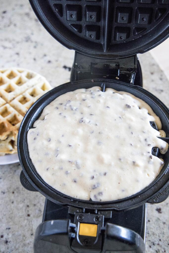 adding batter to waffle iron