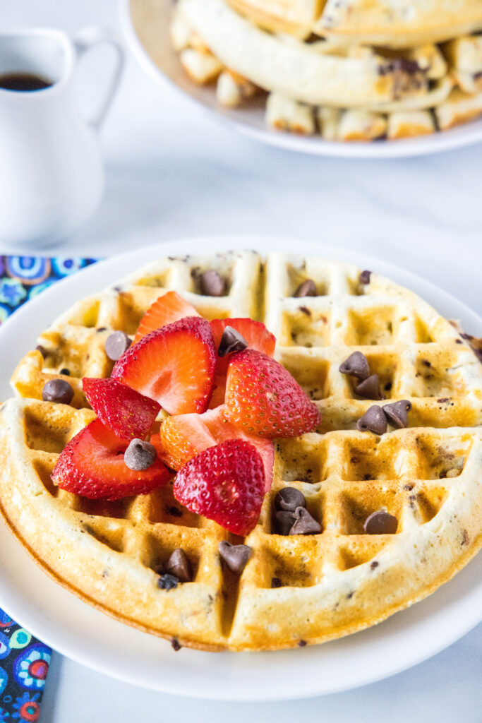 chocolate chip waffle on a plate with berries