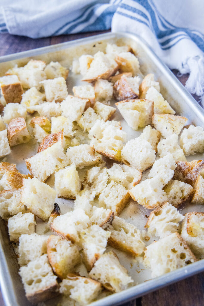 bread cubes tossed with oil and salt and pepperon baking tray
