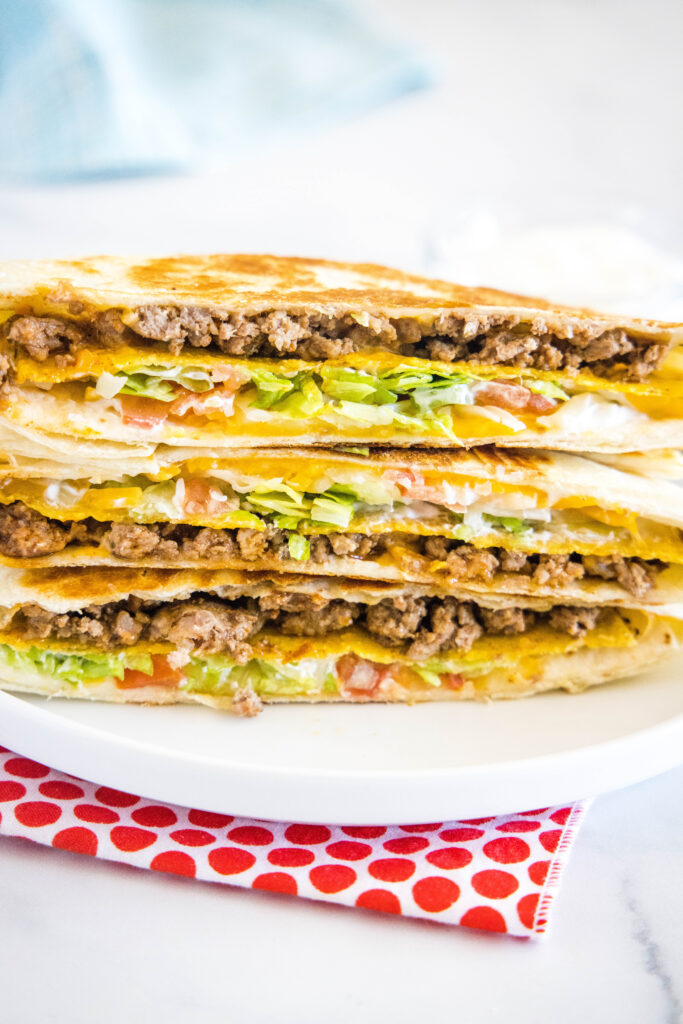 stacked taco bell crunchwrap on a plate