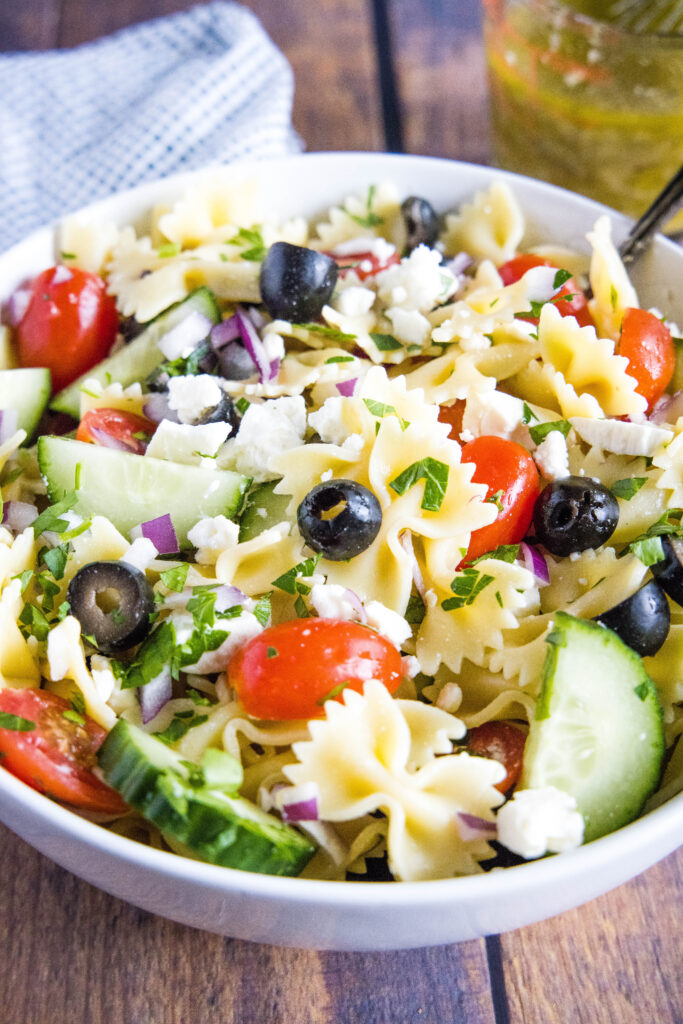 pasta salad mixed together in a bowl