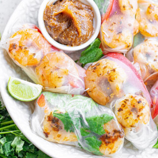 cropped square image of shrimp rolls on a plate
