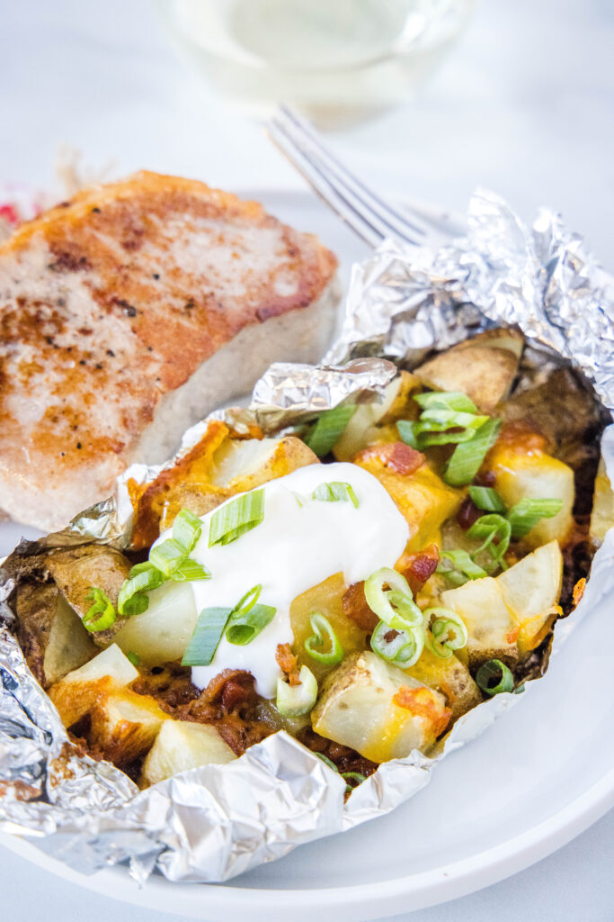 grilled potatoes in foil pack on a plate