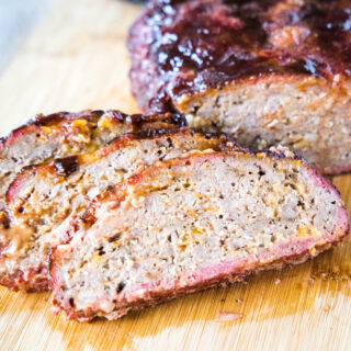 close up sliced meatloaf on a cutting board