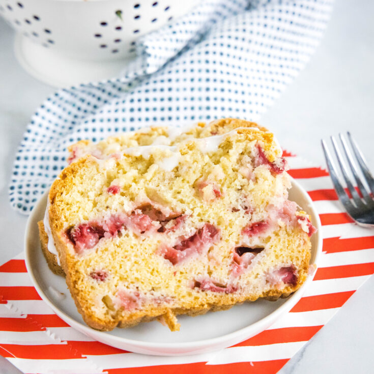 close up of a slice of strawberry bread on a plate