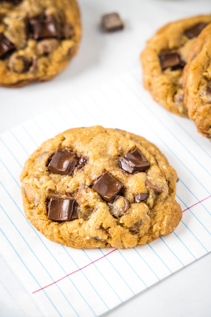 chocolate chunk cookies on a white surface