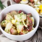 close up lemon potato salad in a small bowl