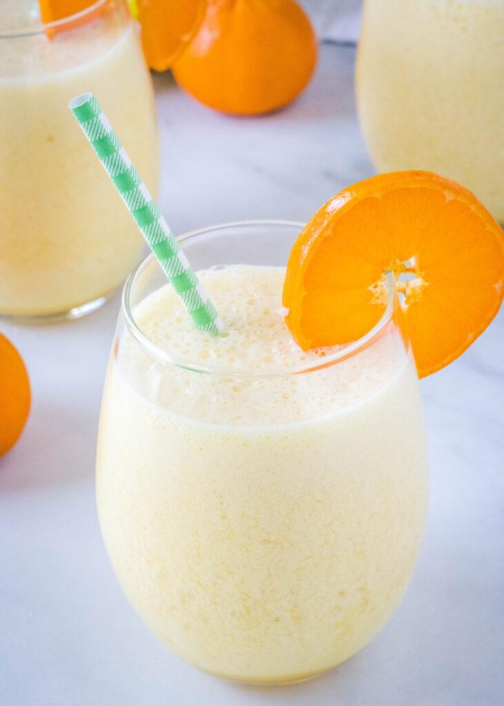orange julius copycat in a glass with a straw
