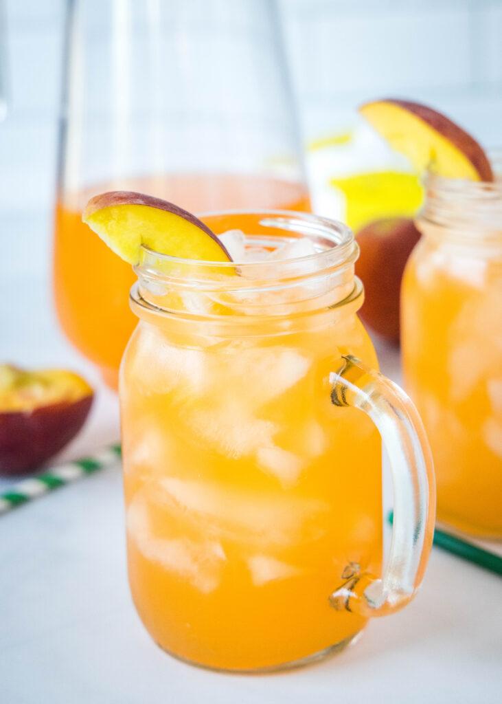glass of homemade peach lemonade with ice