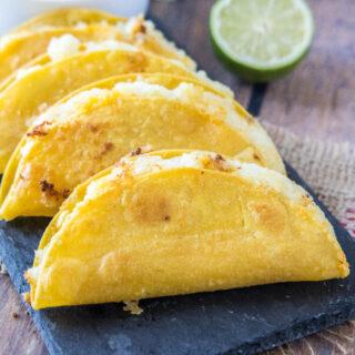 close up of crispy potato tacos on a tray