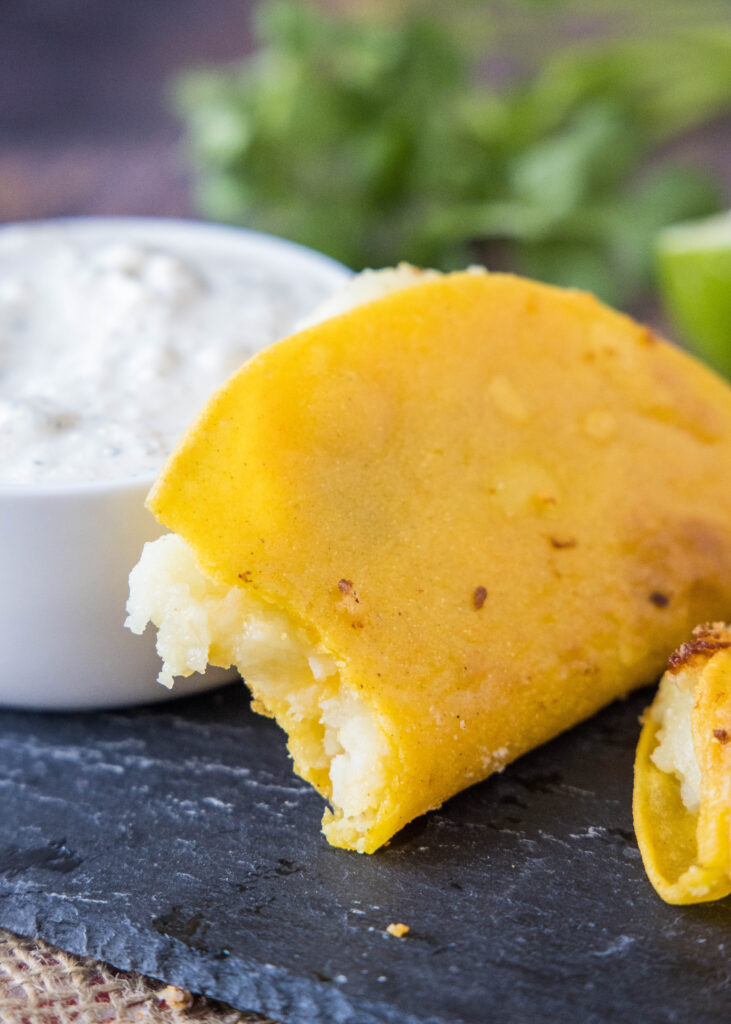 mashed potato tacos with a bite taken out of it