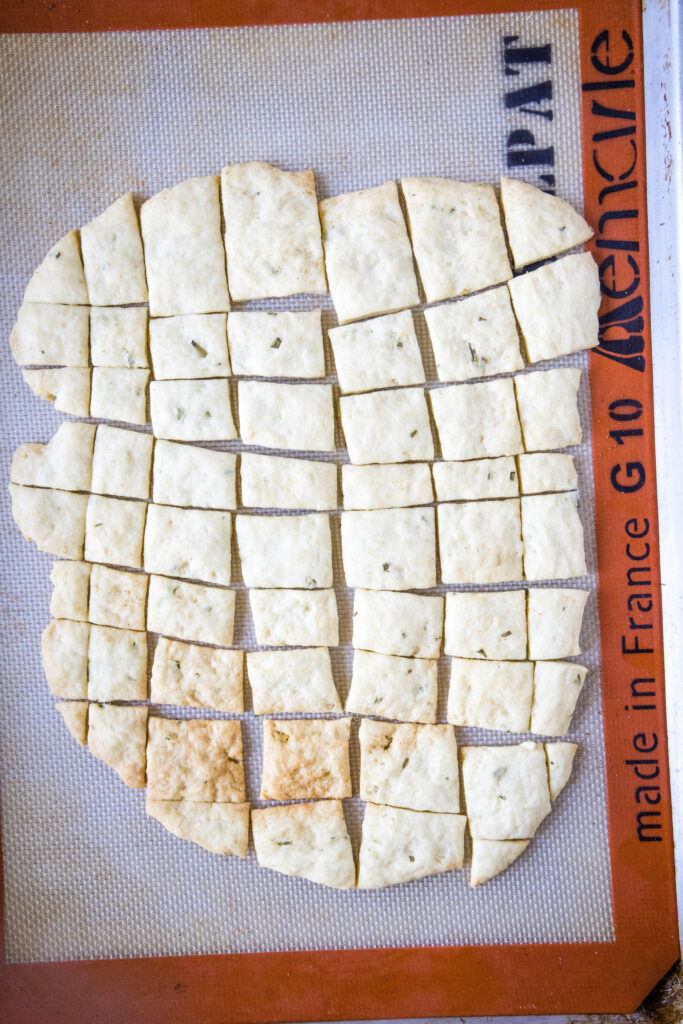 baked crackers on a baking mat