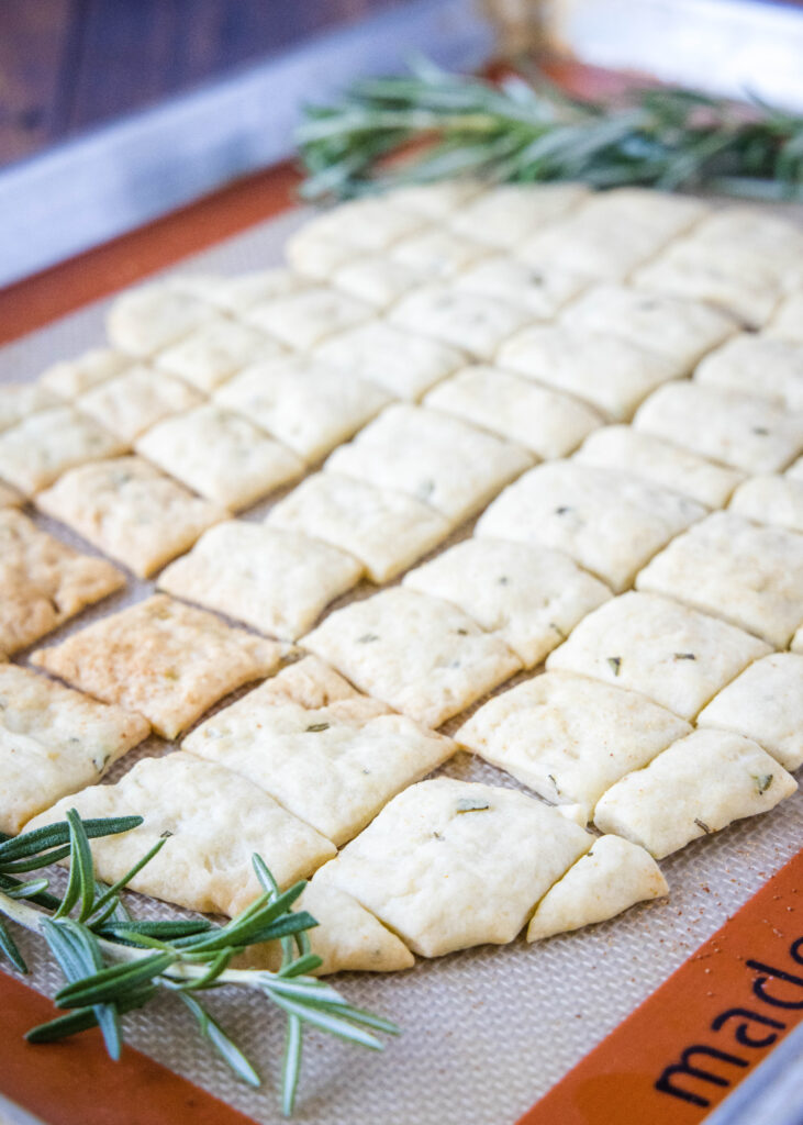 rosemary crackers on a baking mat