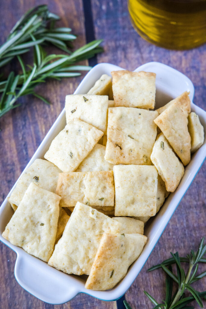 crackers in a bowl with sprigs of rosemary