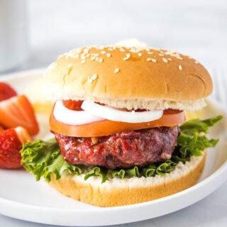 close up of a smoked burger on a bun