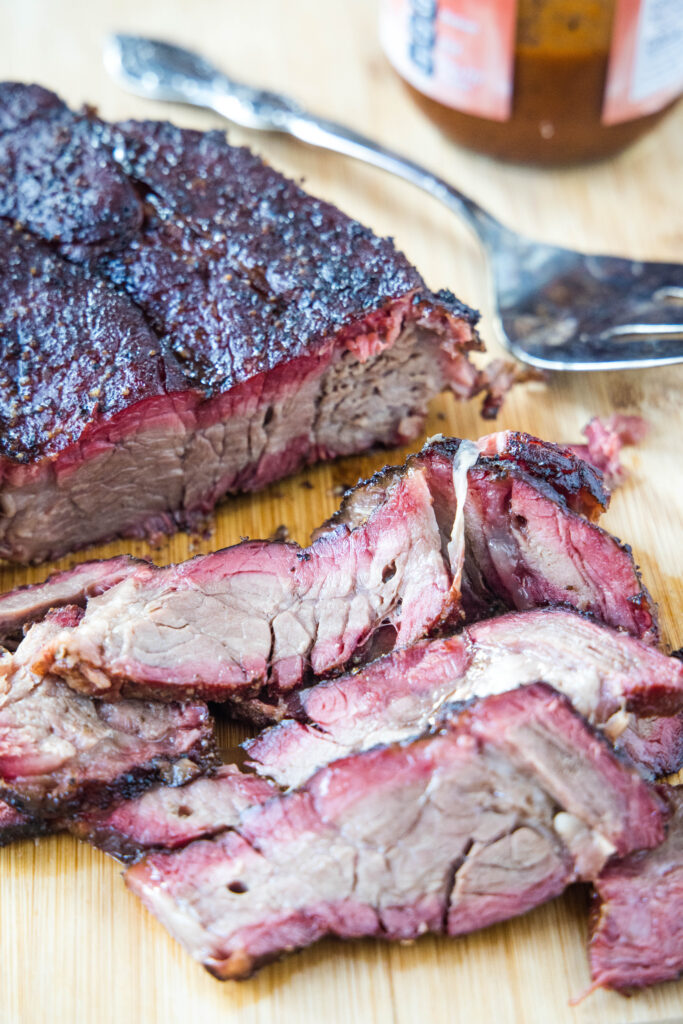 sliced beef chuck roast on cutting board