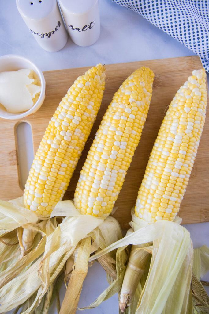 corn on the cob on a cutting board