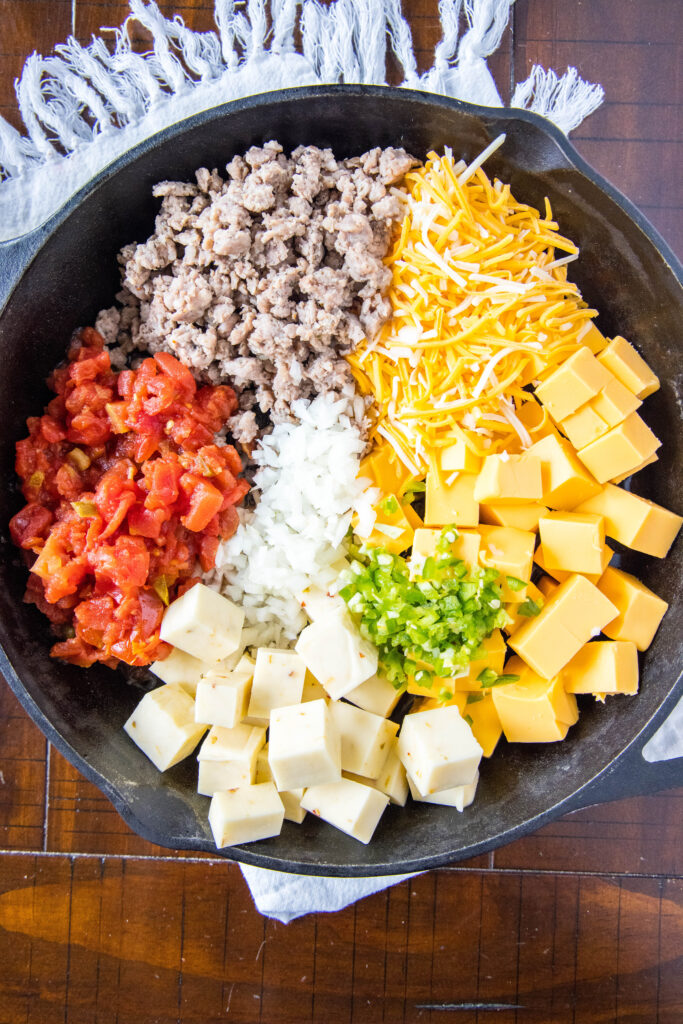 ingredients for queso in cast iron skillet