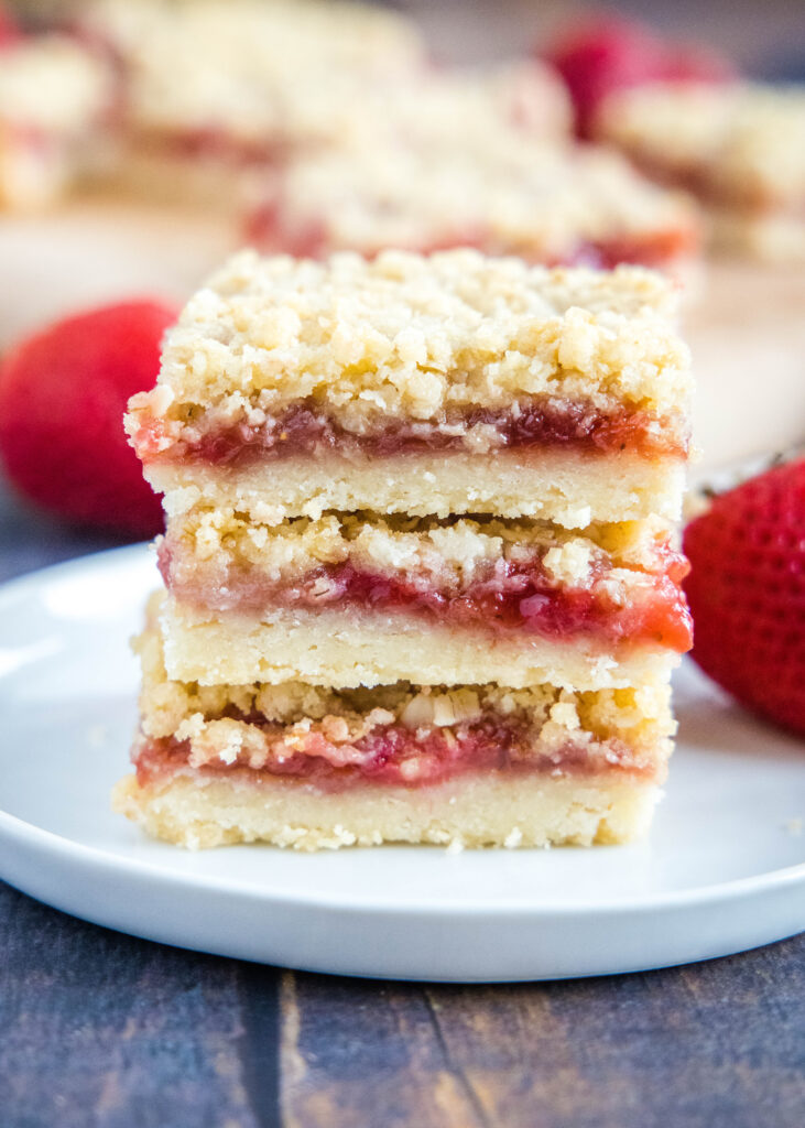 strawberry streusel bars stacked on a plate