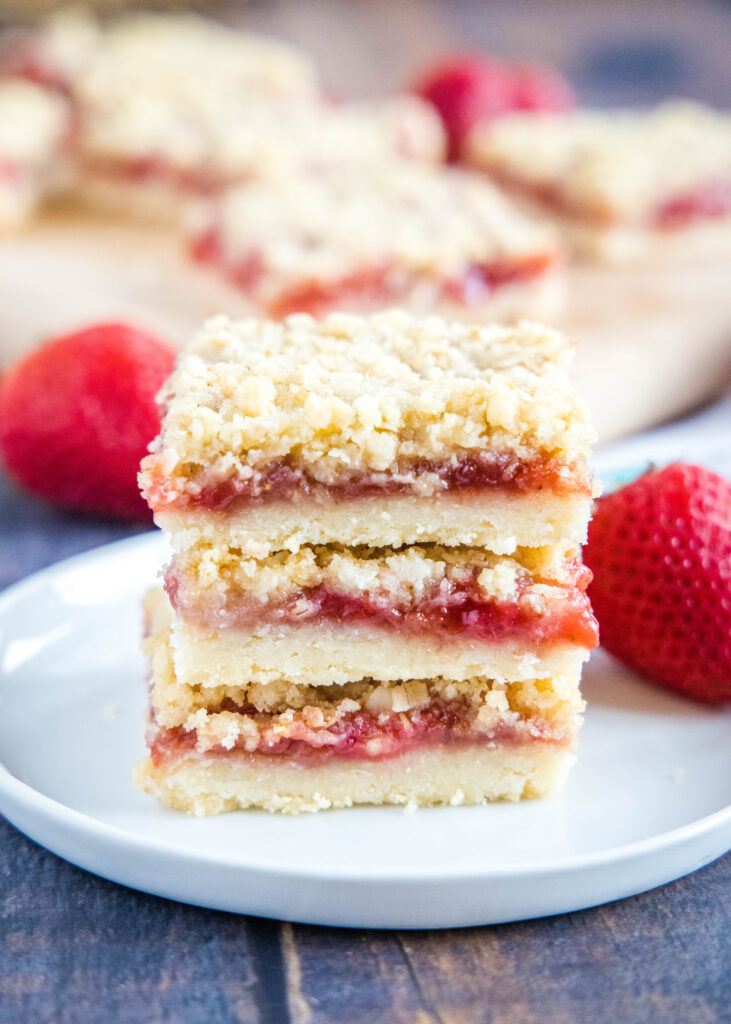 stacked strawberry bars on a plate