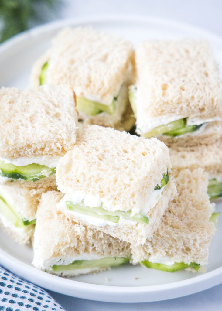 looking down on a plate of cucumber sandwiches