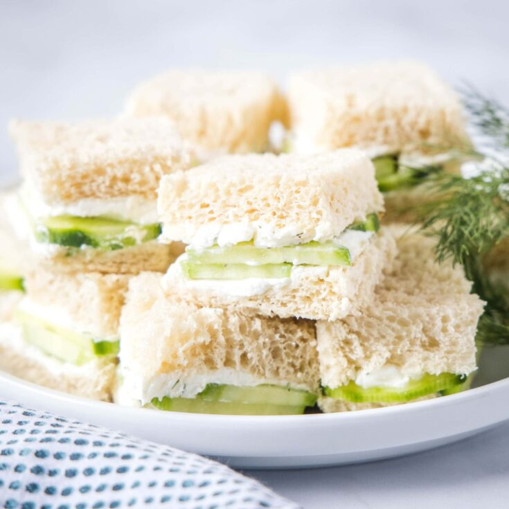 cropped in of a plate of cucumber tea sandwiches