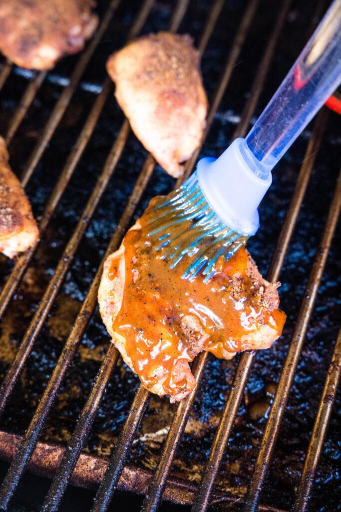 brushing sauce on chicken