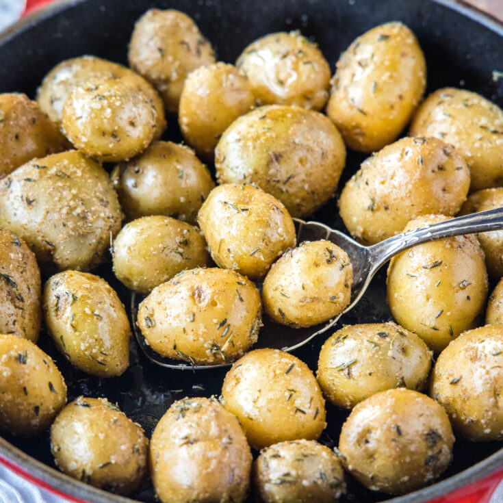 cropped in picture of smoked potatoes on a spooon