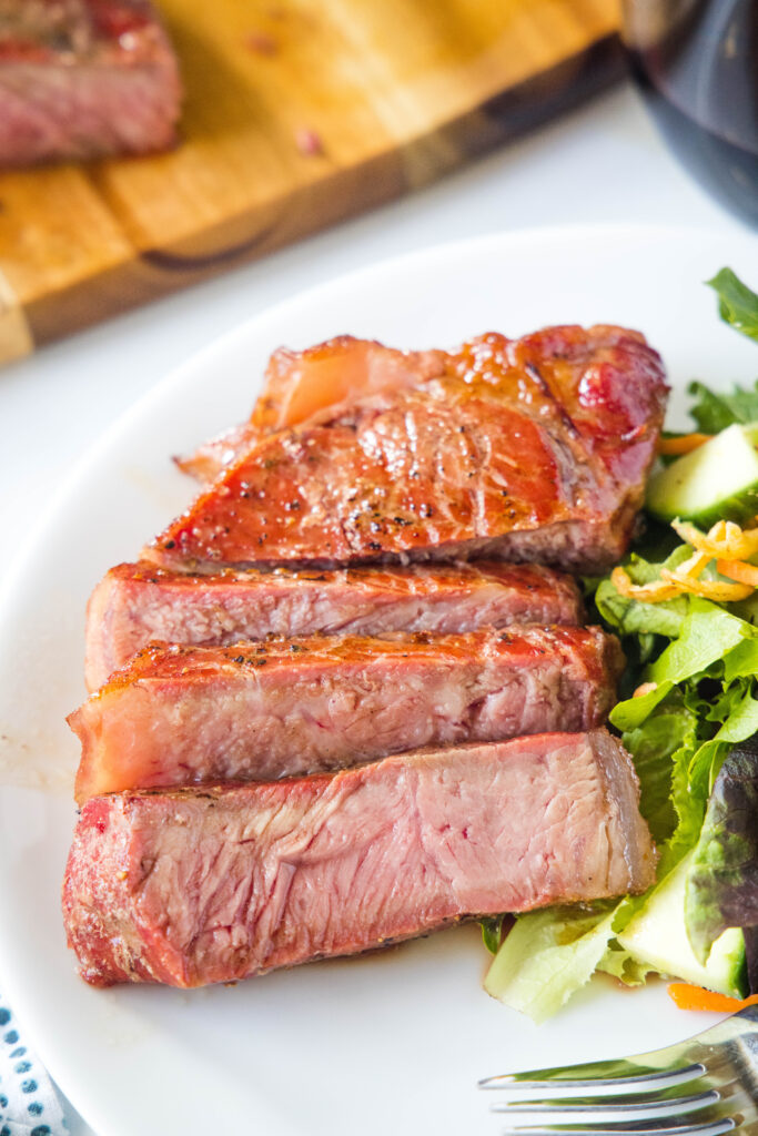 smoked steak on a plate with salad
