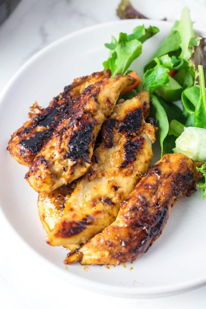 italian schicken tenders on a plate
