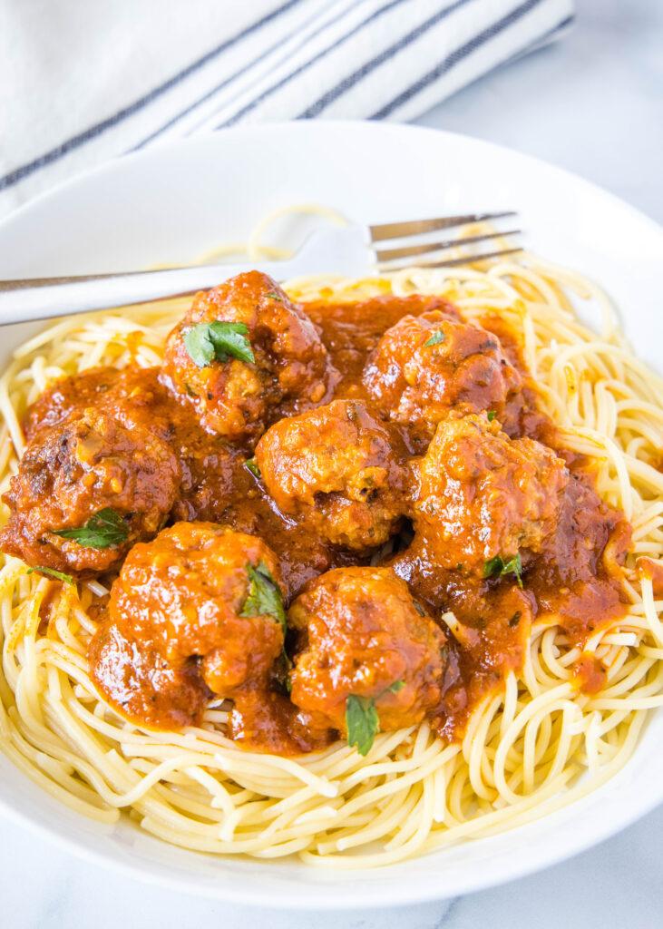 meatballs in marinara sauce over spaghetti