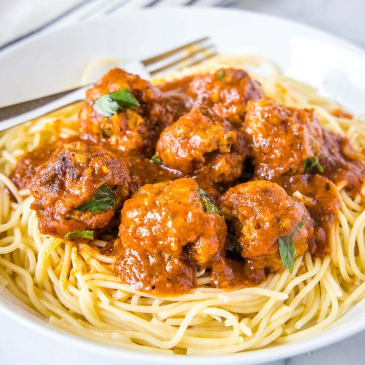 close up meatballs on spaghetti