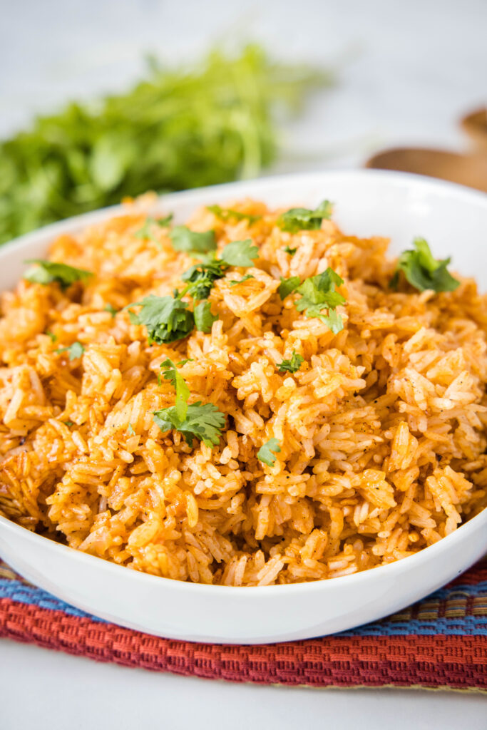 mexican rice in a bowl topped with cilantro
