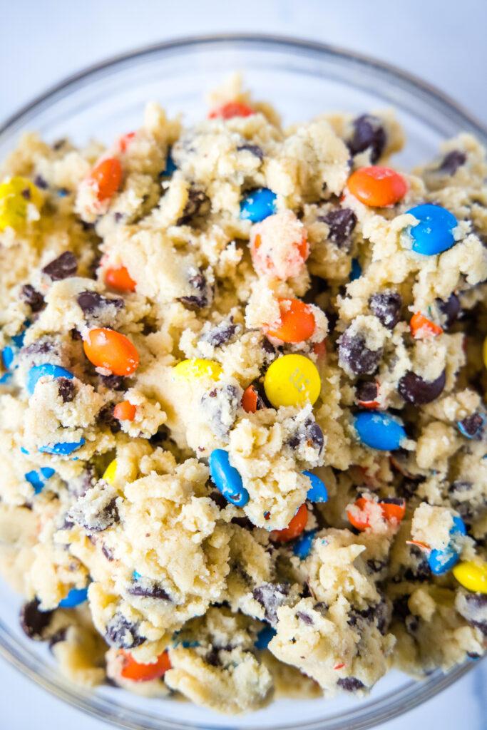 a bowl of M&M cookie dough