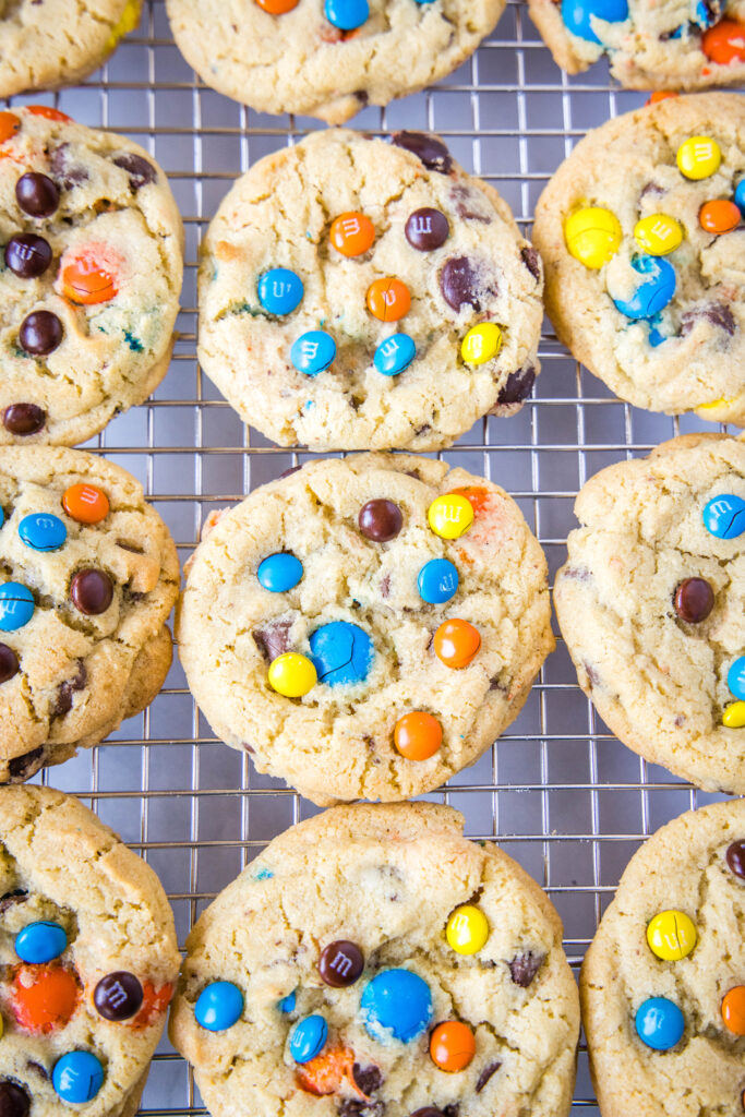 looking down on a cooling rack of M&M cookies