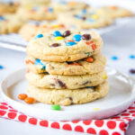close up of cookies stacked on a white plate