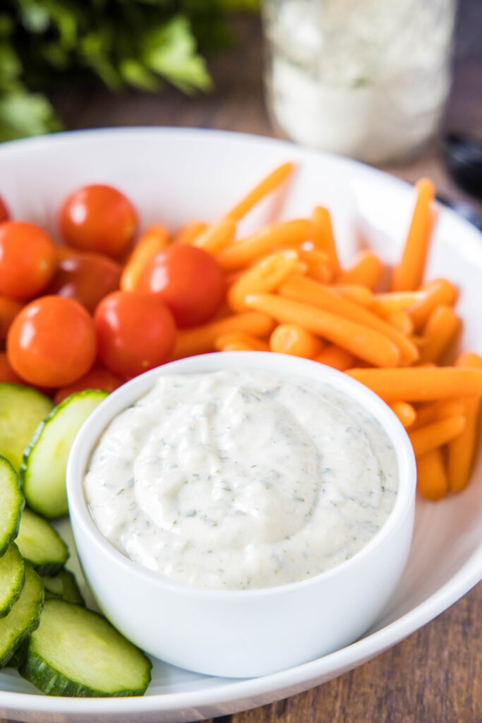 homemade ranch dressing in a bowl with vegetables