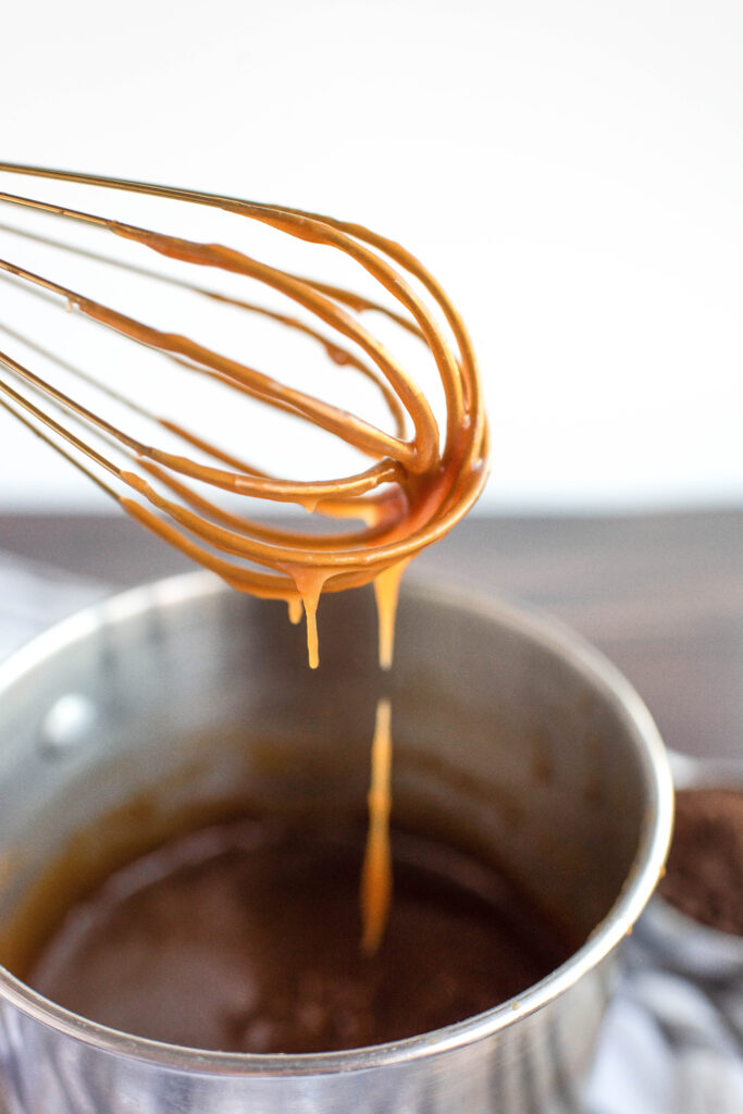 caramel sauce on a whisk