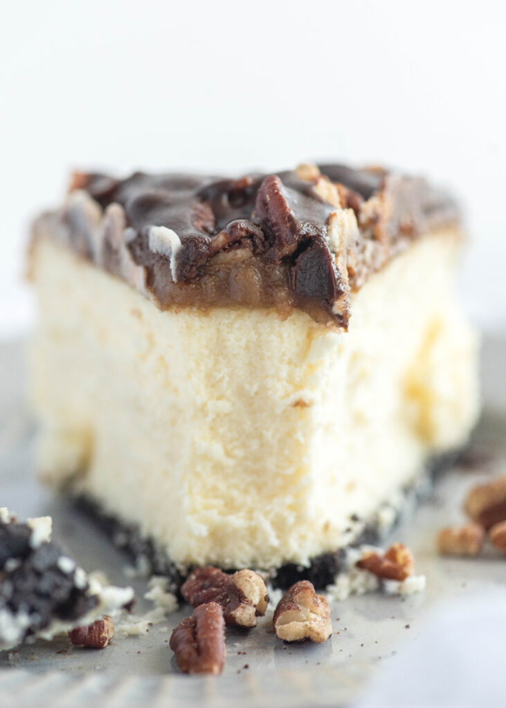 close up of creamy turtle cheesecake