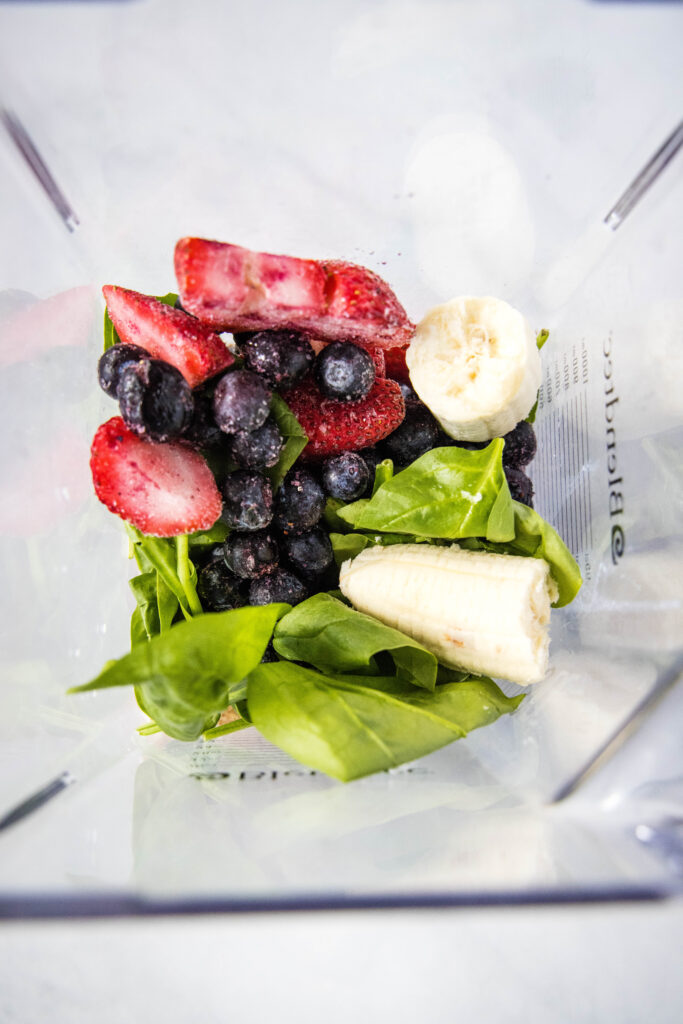 ingredients in blender for berry smoothie